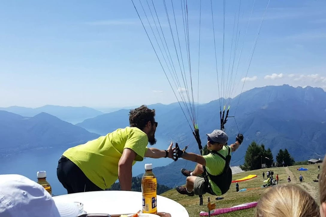 Paragliding High Five at Cimetta