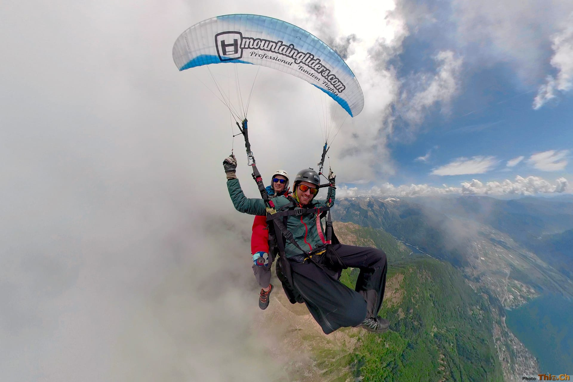 Into the clouds with a tandem paraglider